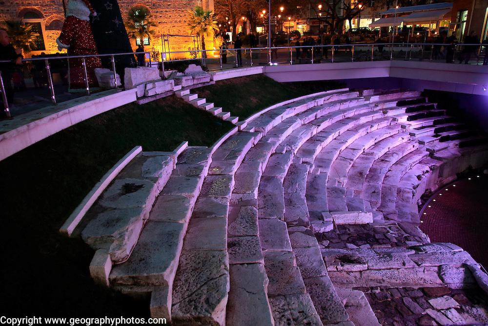 Roman stadium steps illuminated at night, city centre of Plovdiv, Bulgaria