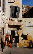 "Clothes hanging on string in front of old houses, Portuguese Fortified city of Mazagan, El Jadida, Morocco. El Jadida, previously known as Mazagan (Portuguese: Mazag""o), was seized in 1502 by the Portuguese, and they controlled this city until 1769. Picture by Manuel Cohen"
