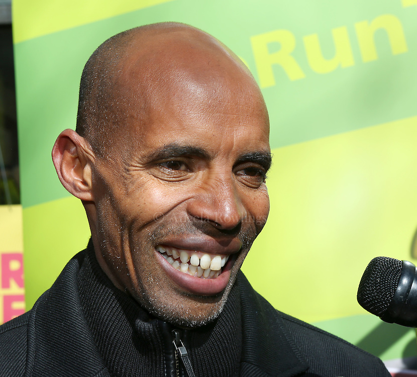 (Boston, MA - 3/19/15) Marathon champion Meb Keflezighi speaks with reporters along Boylston Street, Thursday, March 19, 2015. Staff photo by Angela Rowlings.