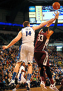 St. Louis  University basketball player Brian Conklin (14) battles Fordham University's Chris Gaston (33) for a rebound during the first half of the Billikens' 66-46 Atlantic 10 win over the Rams at Chaifetz Arena on the St. Louis University campus Saturday, Feb. 18, 2012 in St. Louis. Photo © copyright 2012 Sid Hastings.