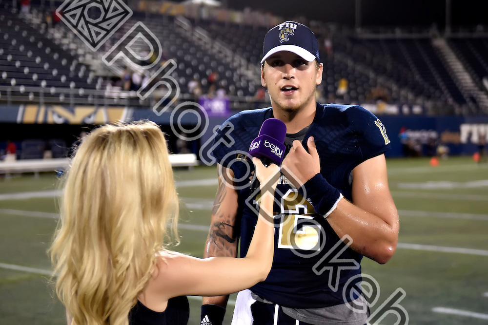 2016 October 01 - FIU's Alex McGough (12). Florida International University defeated Florida Atlantic University, 33-31, during the Shula Bowl, at Ocean Bank Field, Miami, Florida. (Photo by: Alex J. Hernandez / photobokeh.com) This image is copyright by PhotoBokeh.com and may not be reproduced or retransmitted without express written consent of PhotoBokeh.com. ©2016 PhotoBokeh.com - All Rights Reserved