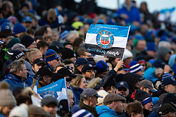 A Bath Rugby fan in the crowd waves a flag in support - Mandatory byline: Patrick Khachfe/JMP - 07966 386802 - 08/12/2018 - RUGBY UNION - The Recreation Ground - Bath, England - Bath Rugby v Leinster Rugby - Heineken Champions Cup