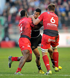 Anthony Watson of Bath Rugby is tackled by Josua Tuisova and Juan Smith of Toulon - Mandatory byline: Patrick Khachfe/JMP - 07966 386802 - 10/01/2016 - RUGBY UNION - Stade Mayol - Toulon, France - RC Toulon v Bath Rugby - European Rugby Champions Cup.