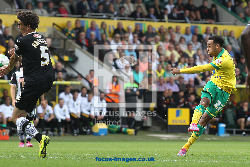 Nathan Redmond of Norwich has a shot on goal during the Sky Bet Championship match at Carrow Road, Norwich<br /> Picture by Paul Chesterton/Focus Images Ltd +44 7904 640267<br /> 16/08/2014