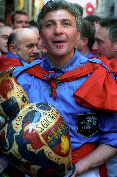 """Gubbio 15 MAY 2004..Festival of the Ceri..The """"capodieci"""" of St George  with the pitcher....http://www.ceri.it/ceri_eng/index.htm.."""