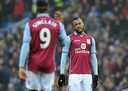 Jordan Ayew of Aston Villa cuts a dejected figure as he speaks with Scott Sinclair - Mandatory byline: Dougie Allward/JMP - 13/12/2015 - Football - Villa Park - Birmingham, England - Aston Villa v Arsenal - Barclays Premier League