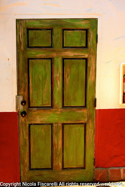 A painted door reflective of mexican influence.