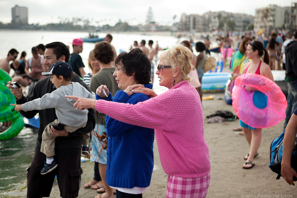 Onlookers watch Floatopia in Mission Bay near Fanuel Street Park in San Diego's Pacific Beach, March 20, 2010. Roughly 5,000 people took to the water to skirt an alcohol ban on San Diego's beaches.