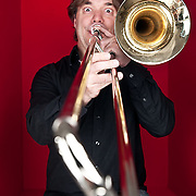 Portrait of James Miller, trombonist for Rumbankete, a Los Angeles, California-based salsa orchestra, taken in Woodland Hills, Calif., on April 3, 2010, for the band's promotional use and album cover.  Photo by Jen Klewitz.  (Jen Klewitz © 2010)