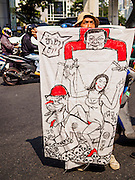 """20 DECEMBER 2013 - BANGKOK, THAILAND:  An anti-government protestor carries a caricature of caretaker Prime Minister Yingluck Shinawatra being manipulated like a puppet by her brother, exiled former Prime Minister Thaksin Shinawatra during an anti-government protest in Bangkok. Thousands of anti-government protestors, supporters of the so called Peoples Democratic Reform Committee (PRDC), jammed the Silom area, the """"Wall Street"""" of Bangkok, Friday as a part of the ongoing protests against the caretaker government of Yingluck Shinawatra. Yingluck dissolved the Thai Parliament earlier this month and called for national elections on Feb. 2, 2014. The protestors want the elections postponed and the caretaker government to step down. The Thai election commission ruled Friday that the election would go on dispite the protests.         PHOTO BY JACK KURTZ"""