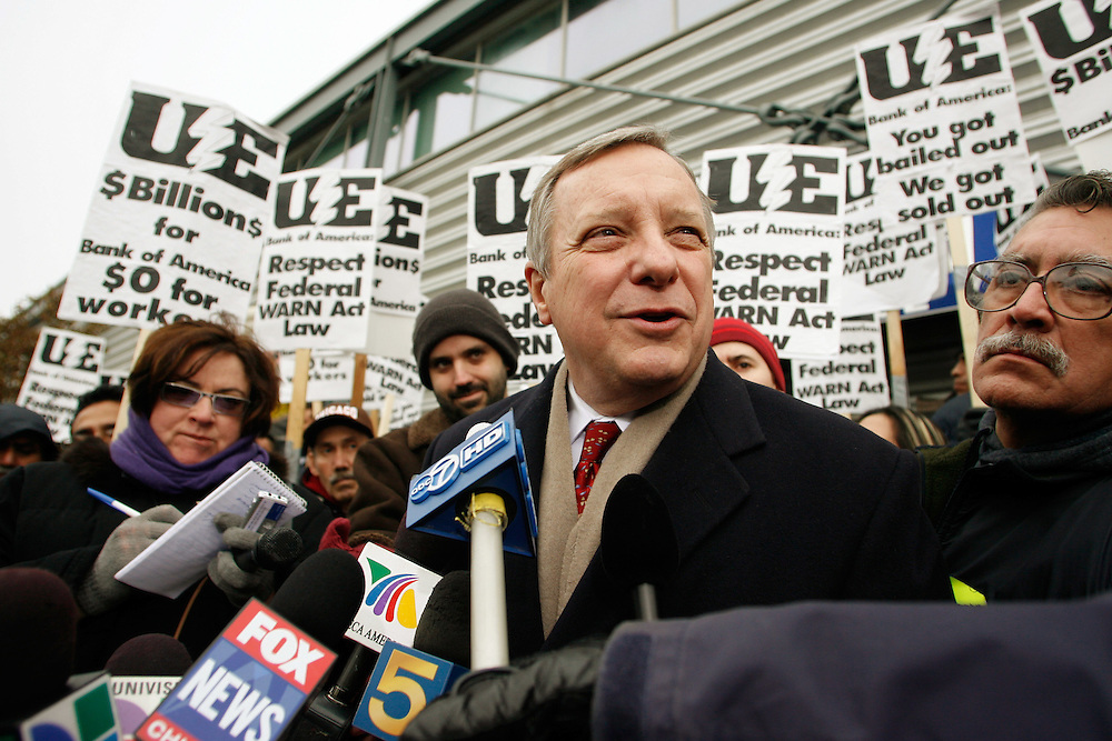 Illinois Senator Dick Durbin speaks to the press after meeting with employees inside Republic Windows & Doors in Chicago Monday morning.  About 300 employees of Republic Windows & Doors are taking turns sitting in at the plant to protest their abrupt firing Friday when the company shut down due to having their line of credit canceled by Bank of America.