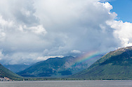 Partial rainbow along the Chugach Mountains along Turnagain Arm in Southcentral Alaska. Summer. Afternoon.