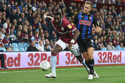Yannick Bolasie of Aston Villa (11) keeps the ball away from Will Vaulks of Rotherham United (4) during the EFL Sky Bet Championship match between Aston Villa and Rotherham United at Villa Park, Birmingham, England on 18 September 2018.