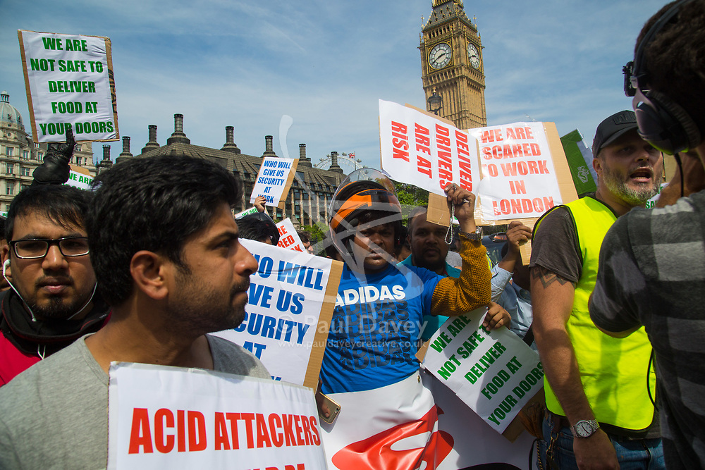 London, July 18th 2017. Hundreds of scooter delivery riders and other motorcyclists protest in Westminster against the surge in violent crimes against them, including acid attacks by other moped-riding gangs.