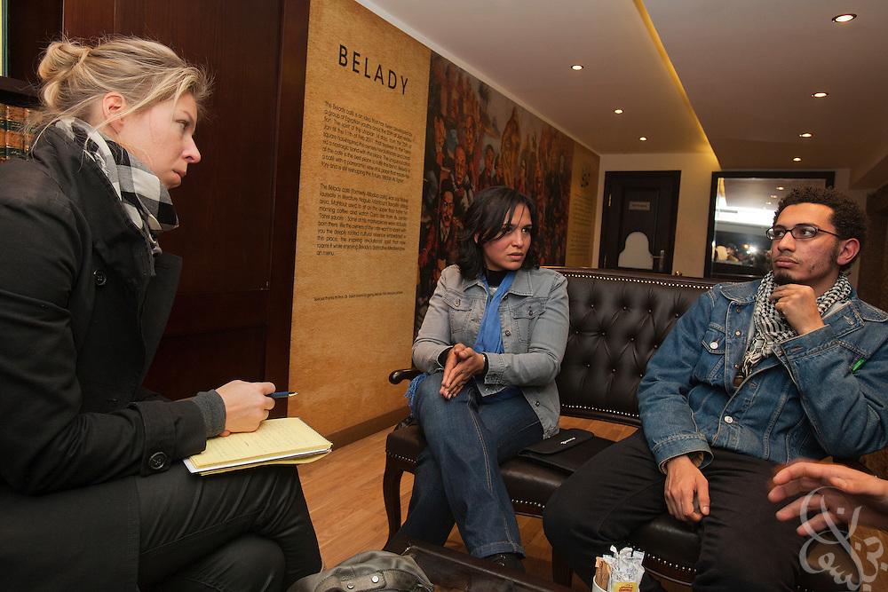 Egyptian activists Michael Adel (r) and Dai Rahmy (l) speak with Der Spiegel correspondent Juliane von Mittelstaedt in a cafe in central Cairo January 17, 2012.