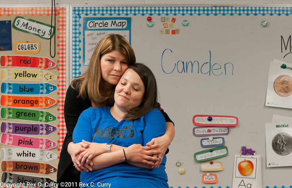Brenda Bingham, left, principal at W.T Hanes Elementary School and Whitney Bruno, the Camden Pierce Hughes' kindergarten teacher. His mother has been charged with his murder.  HIs name was on the board while they drew pictures for him during class.