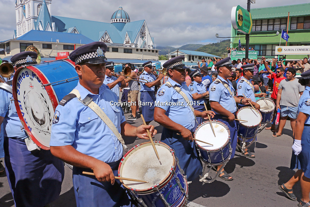 The Samoa National Police Band led the Manu Samoa/All Black Test celebration parade from the Apia Fire Station to the Apia Clock Tower on Beach Rd., Apia, Upolu, Samoa.  Manu Samoa will take on the NZ All Blacks in a historic first time test at Apia Park, Fatoia, Upolu, Samoa.  Photo by Barry Markowitz, 7/7/15