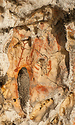 Prehistoric rock art on a cliff face near Mai Mai village, Namatota Strait, near Kaimana, Papua. One of the paintings resembles a fishing net.