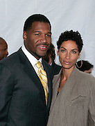 Michael Strahan and Nicole Murphy pose at the Fox 2009 Programming Presentation Post-Party Arrivals at Wollman Rink in New York City, USA on May 18, 2009.