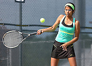 Iowa City West's Navya Mannengi returns the ball during the Class 2A state team tennis tournament at Veterans Memorial Tennis Center in Cedar Rapids on Saturday, June 1, 2013.