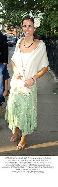 MISS OCTAVIA KHASHOGGI at a wedding in Suffolk in London on 20th September 2003.PMT 104