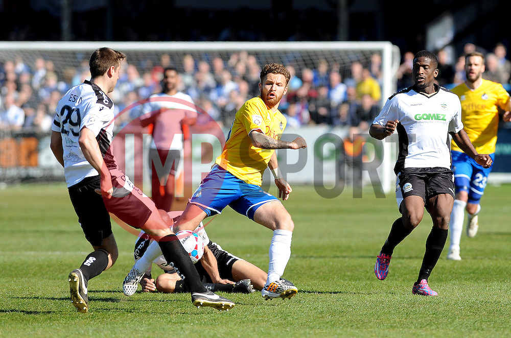 Bristol Rovers' Matty Taylor challenges Dover Athletic's Connor Essam - Photo mandatory by-line: Neil Brookman/JMP - Mobile: 07966 386802 - 18/04/2015 - SPORT - Football - Dover - Crabble Athletic Ground - Dover Athletic v Bristol Rovers - Vanarama Football Conference