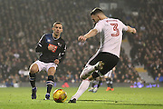 Fulham defender Scott Malone (03) clearing from Derby County striker Andreas Weimann (24) during the EFL Sky Bet Championship match between Fulham and Derby County at Craven Cottage, London, England on 17 December 2016. Photo by Matthew Redman.