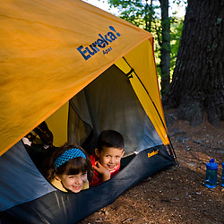 A young brother and sister in their tent in the campground in New Hampshire's Pawtuckaway State Park.