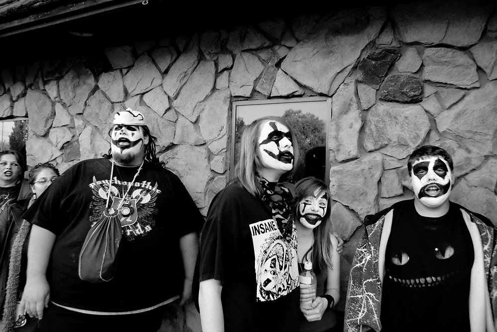 """Ogre,"" left, of Richland, leads more than 100 juggalos lined up outside Ray's Golden Lion in Richland in a chant of ""family"" as they waited to see Detroit-based rapper ABK on April 28, 2010. Juggalos are fans of artists on the Psychopathic Records label and have developed into a subculture. ""We come down here and see people we haven't seen in a while,"" says Ogre. ""It's like a little family reunion every time,"" says ""Bael"" (not pictured). Ogre says they prefer to use nicknames at the shows. ""We all have other names from before we knew each other,"" he says. ""The thing we all have in common is that we've all been on the outside at some point."""