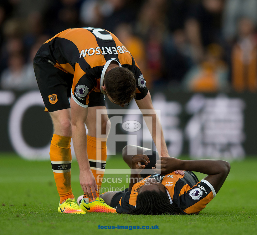 Andrew Robertson of Hull City (left) inquires about the wellbeing of team-mate Dieumerci Mbokani during the Premier League match at the KCOM Stadium, Hull<br /> Picture by Russell Hart/Focus Images Ltd 07791 688 420<br /> 17/09/2016