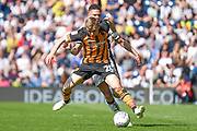 Hull City midfielder Jarrod Bowen (20) holds off West Bromwich Albion defender Kieran Gibbs (3) during the EFL Sky Bet Championship match between West Bromwich Albion and Hull City at The Hawthorns, West Bromwich, England on 19 April 2019.