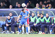 Andy Barcham of AFC Wimbledon and Pietro Mingoia of Accrington Stanley FC tussle during the Sky Bet League 2 match between AFC Wimbledon and Accrington Stanley at the Cherry Red Records Stadium, Kingston, England on 5 March 2016. Photo by Stuart Butcher.