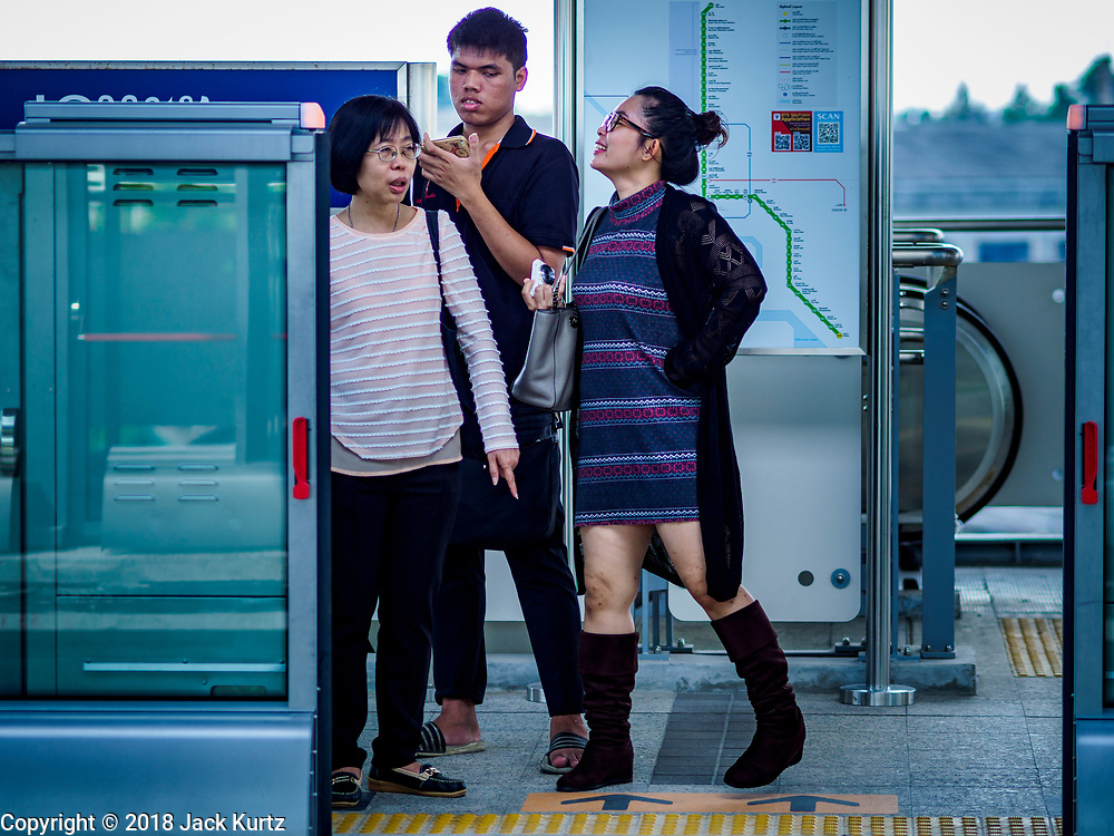 06 DECEMBER 2018 - SAMUT PRAKAN, THAILAND:  Passengers wait for the train to come into the Kheha station, the last station on the BTS Skytrain on the opening day of the extension. The 12.6 kilometer (7.8 miles) east extension of the Sukhumvit Line of the Bangkok BTS Skytrain goes into Kheha station in Samut Prakan, a town east of Bangkok.  The system is now 51 kilometers long (32 miles), including the 12.6 kilometer extension that opened December 06. About 900,000 people per day use the BTS.      PHOTO BY JACK KURTZ
