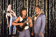 © Tony Nandi. 04/06/2015. Coup Fatal features Congolese counter-tenor Serge Kakudji, with an orchestra of 12 musicians from Kinshasa integrating Baroque phrases with traditional and popular Congolese music, rock and jazz. Sadler's Wells Theatre, London. Picture features acoustic guitarist Costa Pinto & counter tenor Serge Kakudji. . Photo credit: Tony Nandi