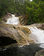 Josephine Falls, within the Wooroonooran National Park, near Babinda, QLD, Australia.
