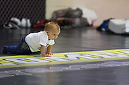 "NOTTINGHAM, ENGLAND, SEPTEMBER 26, 2012: A young Dan Hardy fan crawls on the mats during the open work-out sessions ahead of ""UFC on Fuel TV 5: Struve vs. Miocic"" inside Gym Combat in Nottingham, United Kingdom on Wednesday, September 26, 2012 © Martin McNeil"