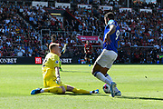 Aaron Ramsdale (12) of AFC Bournemouth slides in to clear the ball as Dominic Calvert-Lewin (9) of Everton looks to shoot during the Premier League match between Bournemouth and Everton at the Vitality Stadium, Bournemouth, England on 15 September 2019.