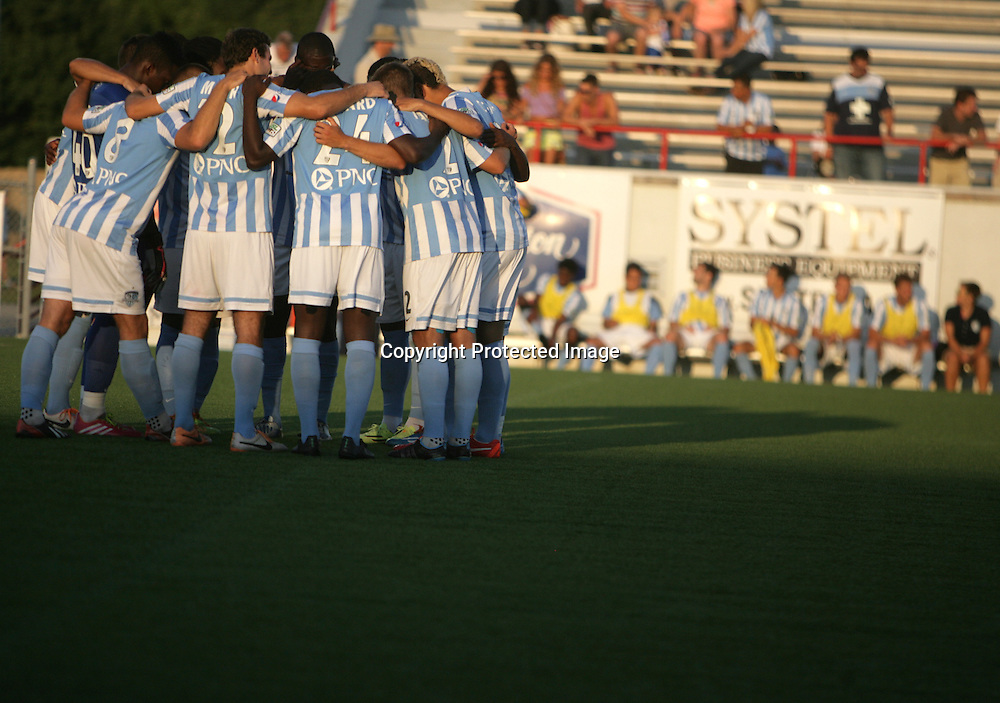 Members of Wilmington Hammerheads FC huddle together before their friendly match against Toronto FC Wednesday June 18, 2014 at Legion Stadium in Wilmington, N.C. (Jason A. Frizzelle)