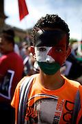 Mainz | 18 July 2014<br /> <br /> Am Samstag (18.07.2014) nahmen etwa 1000 M&auml;nner, Frauen und Kinder in der Innenstadt von Mainz anl&auml;sslich der milit&auml;rischen Auseinandersetzung zwischen Israel und der Hamas in Gaza an einer Solidarit&auml;tsdemonstration f&uuml;r Gaza, ein freies Pal&auml;stina und gegen Israel teil. Bei der Demo wurden Fahnen der Hamas und der Hisbollah mitgef&uuml;hrt, neben den &uuml;blichen Parolen gegen Israel wurde in Sprechch&ouml;hren auch vereinzelt zur Vernichtung von J&uuml;dinnen und Juden aufgerufen.<br /> Hier: Ein Jugendlicher hat sich eine pal&auml;stinensische Fahne auf das Gesicht gemalt.<br /> <br /> <br /> &copy;peter-juelich.com<br /> <br /> [No Model Release | No Property Release]