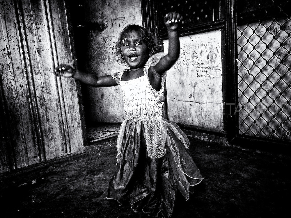 Quane (2yr) dancing in his sisters dress at his family home in Kennedy Hill, an Aboriginal Community in the centre of Broome. Unaware of the problems his Community is dealing with.  Broome, Western Australia ©Ingetje Tadros/Diimex