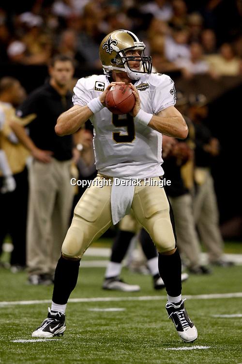 September 9, 2010; New Orleans, LA, USA; New Orleans Saints quarterback Drew Brees (9) during warm ups prior to kickoff of the NFL Kickoff season opener at the Louisiana Superdome. The New Orleans Saints defeated the Minnesota Vikings 14-9.  Mandatory Credit: Derick E. Hingle