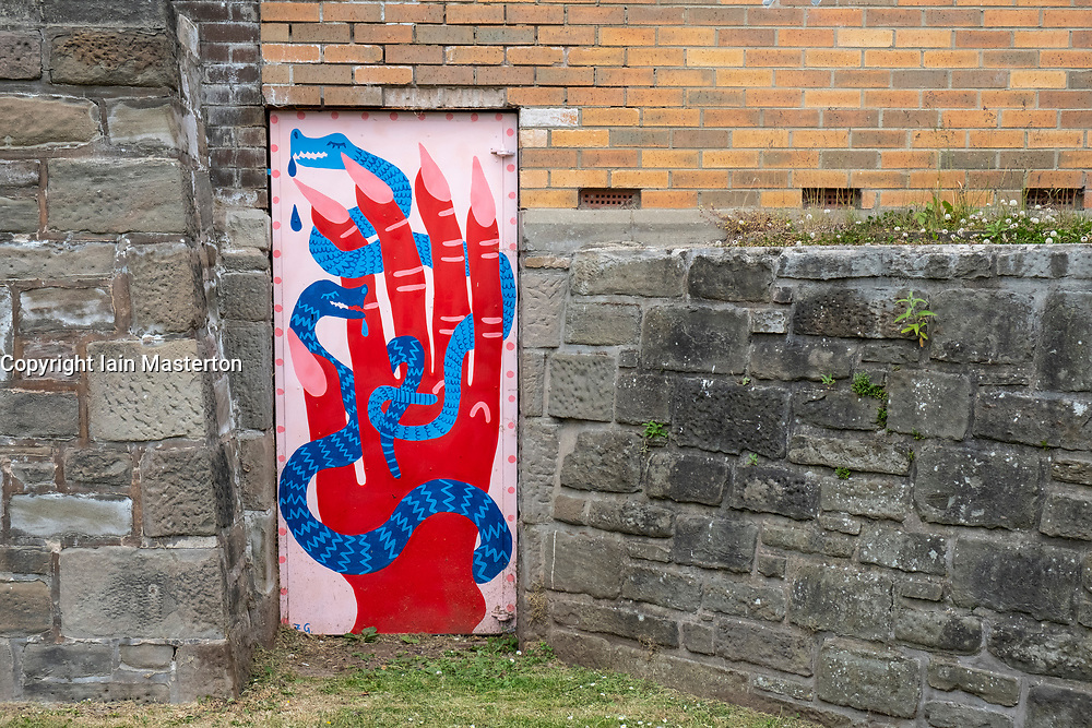 Street art project Openclose Dundee using art on doors in out of the way alleyways and lanes by local artists in the city. Dundee,Scotland, UK. Victoria Bridge Arches works by Zoe Gibson