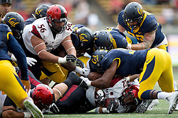 BERKELEY, CA - SEPTEMBER 12:  Running back Chase Price #22 of the San Diego State Aztecs is tackled by linebacker Raymond Davison #31 of the California Golden Bears during the first quarter at California Memorial Stadium on September 12, 2015 in Berkeley, California. The California Golden Bears defeated the San Diego State Aztecs 35-7. (Photo by Jason O. Watson/Getty Images) *** Local Caption *** Chase Price; Raymond Davison