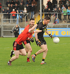 Louisburgh's Padraig O'Malley tries to get past Glenbeigh's Tommy Cahill.<br />