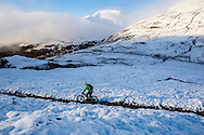 A rider descends through the snow on stage three of the Kinlochleven Enduro.