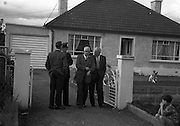 "15/08/1960<br /> 08/15/1960<br /> 15 August 1960<br /> Murder scene at Golden Bridge Walk, Inchicore, Dublin. Chief Superintendent George Lawlor (Technical Bureau) (centre) and D/O Larry Flood, leaving the house ""Cheznous"" at Golden Bridge Walk, Inchicore, in which Miss Margaret O'Loughlin (18) was found dead."