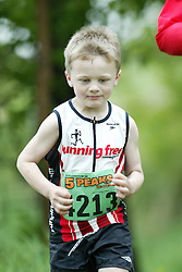 "(Kingston, Ontario---16/05/09) ""Ethan Sparks running in the kids race at the 2009 Salomon 5 Peaks Trail Running series Race held in Kingston, Ontario as part of the Eastern Ontario/Quebec division. ""  Copyright photograph Sean Burges / Mundo Sport Images, 2009. www.mundosportimages.com / www.msievents.com."