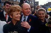 "Leader of the Labour party, Neil Kinnock and wife Glenys campaign during the 1992 election on 5th May 1992, in London, UK. Labour made considerable progress in the election that year reducing the Conservative majority to just 21 seats. It came as a shock to many when the Conservatives won a majority, but the ""triumphalism"" perceived by some observers of a Labour party rally in Sheffield may have helped put floating voters off. Neil Gordon Kinnock, Baron Kinnock PC (b1942) is a British Labour Party politician. He served as a Member of Parliament from 1970 until 1995, first for Bedwellty and then for Islwyn. He was the Leader of the Labour Party and Leader of the Opposition from 1983 until 1992, making him the longest-serving Leader of the Opposition in British political history."