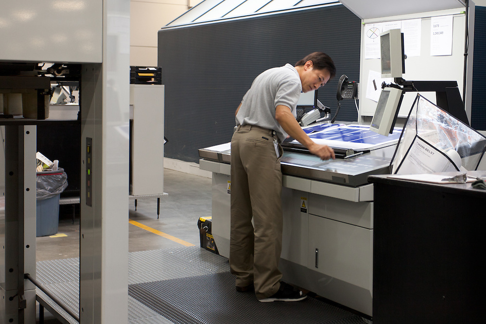 A technician inspects a proof from one of the large offset printers at Classic Graphics in Charlotte, NC.