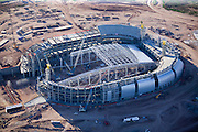 University of Phoenix Stadium is a football stadium in Glendale, Arizona. Its primary tenant is the Arizona Cardinals of the NFL. The new stadium is located across the street from the Jobing.com Arena. The University of Phoenix, a for-profit university specializing in adult education, acquired the naming rights in September 2006, shortly after the stadium had opened under the name Cardinals Stadium. The 63,500-seat stadium (expandable to 72,800) opened on August 12, 2006 when the Cardinals defeated the Pittsburgh Steelers, 21-13, in a preseason game. The first regular season game was played September 10 against the San Francisco 49ers (the Cardinals won 34-27). This was the first time the Cardinals played on the opening weekend of the NFL season at home since moving to Arizona in 1988. The stadium will also be home to the annual Fiesta Bowl and, once every four years, the BCS National Championship Game. In 2008, the stadium will host Super Bowl XLII. It will host Mexico @ United States in a friendly soccer match on February 7, 2007. It will additionally host the Fiesta Bowl National Band Championship High School Marching Band competition, and the first marching band to ever play on the field was Foothill High School, from Pleasanton, California on December 29, 2006. It will also be the site for the West Regional Finals of the 2009 NCAA Men's Division I Basketball Tournament. The ceremonial groundbreaking for the new stadium was held on April 12, 2003. The estimated cost of the project is $455 million. The $455 million includes the cost of acquiring the land, constructing the stadium and $41.7 million for site improvements planned directly outside the venue. The Arizona Cardinals will contribute at least $147 million, and the Arizona Sports and Tourism Authority will spend more than $298 million. Glendale, where the stadium is located, will put in $9.5 million. The facility features a first-of-its kind retractable roof that is 206 feet (63 m) above grade, with a cabl